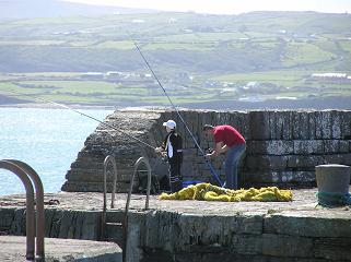 Fishing from the pier in Liscannor
